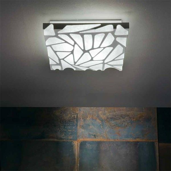 The Studio Italia Grace ceiling / wall light is a modern innovative lamp with a cocoon diffuser giving it a warm textured glow to create a comfortable ambience in any area in which it is installed