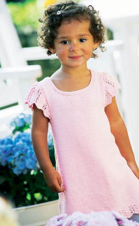 Sød sartrosa tunika, der er lige fin som kjole, når det er varmt, og over bukser og T-shirt, når det er koldt.