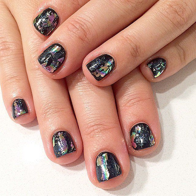 A touch of foil adds some serious glam to an ordinary black manicure.