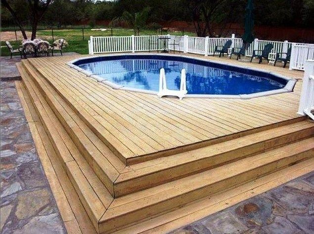 Above Ground Pool With A Wood Deck In San Antonio Texas Above Ground Swimming Pools Backyard Pool Pool Deck Plans