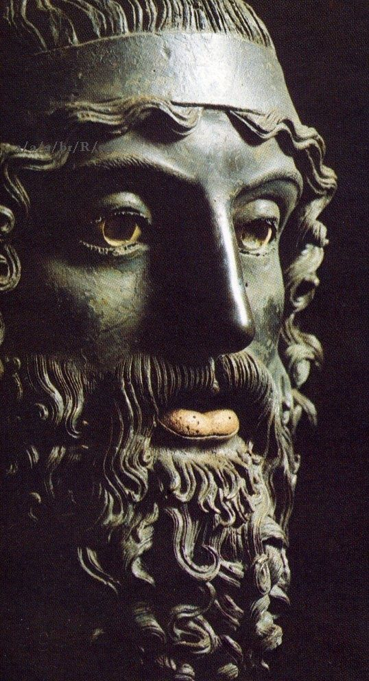 GREECE CHANNEL | Close up of one of the Riace Bronzes, or Riace Warriors.  Two full-body statues found  buried in the sand of the Mediterranean Sea by a diver.  The ancient Greek bronzes are dated at 460 - 450 B.C.