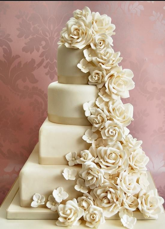 White Four Tiered Wedding Cake With Flowers