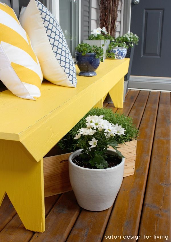 A furniture piece with a bit of character, like this yellow bench, and throw pillows in varying prints and colors add a bit of cottage charm to your front porch. Via @Shauna Oberg @ Satori Design: Cottages Style, Spring Front, Spring Outdoor Diy Decor Ideas, Spring Porches, Yellow Benches, Porches Ideas, Cottages Charms, Front Porches, Porches Benches