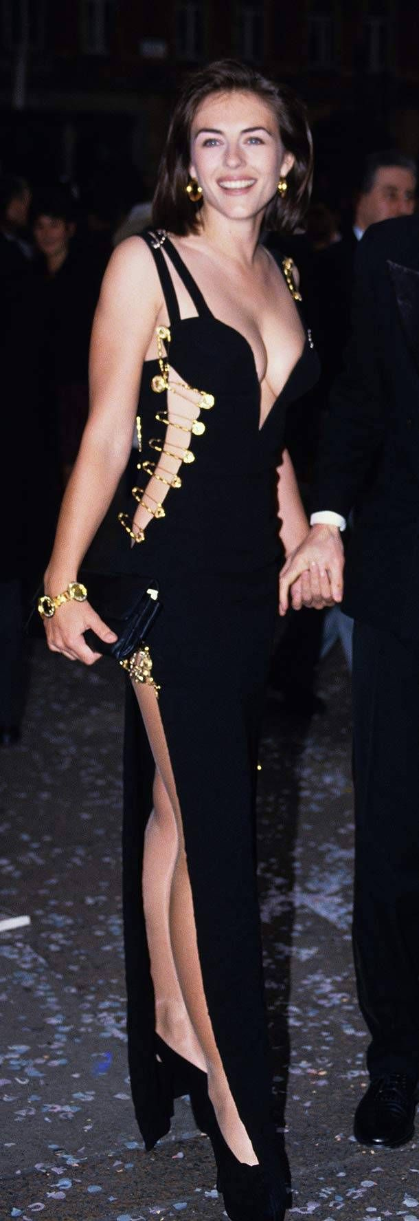 Elizabeth Hurley in Gianni Versace -- having make believe clothes pins holding your dress together is not a good look. tacky, tacky...