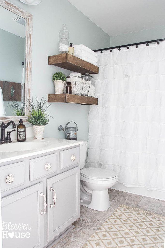 Pretty farmhouse bathroom makeover - love the gray walls!