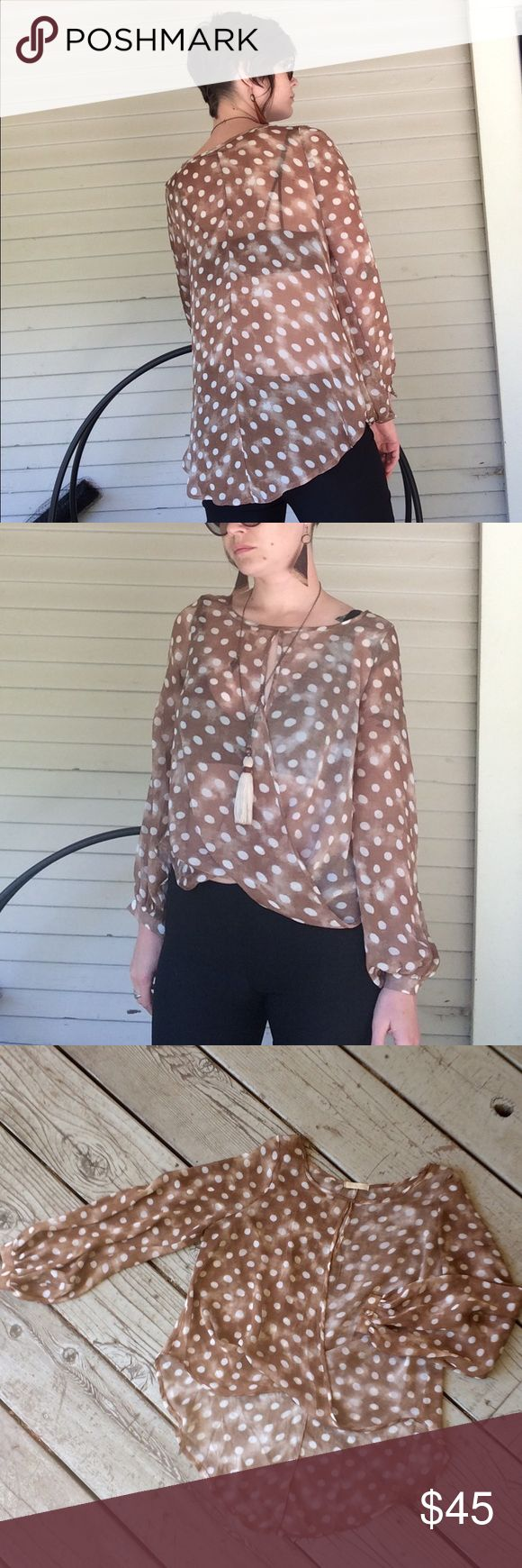 Sheer polka-dot high low top Long sleeved flowy polka dot top with cross over front and billowing sleeves.  Great with a cami or a pretty bra underneath. M.Fredric Tops Blouses