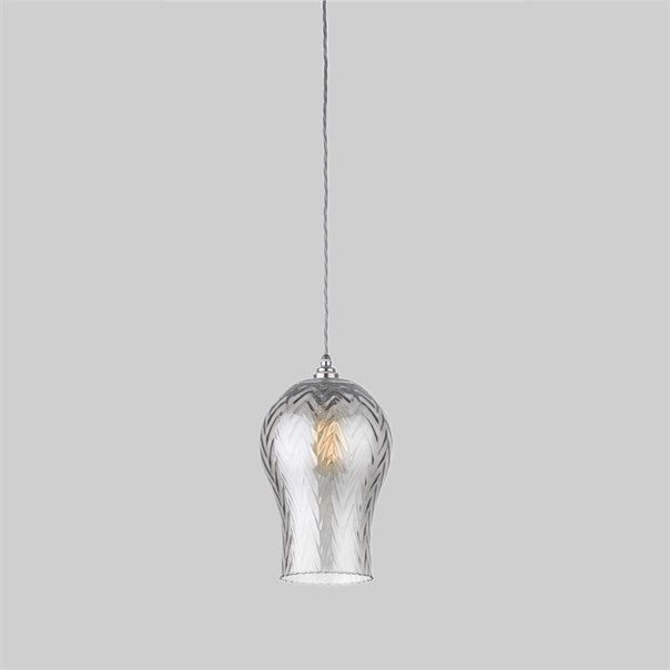 The Tulipe lamp is an elegantly shaped pendant, decorated with a subtle herringbone surface pattern. The complexity of the iridescent smokey glaze adds an element of luxury to this design.