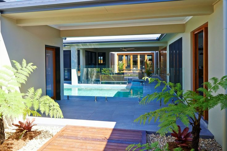 Your tropical oasis awaits  Make the most of outdoor living with this unique home with a modern take on Balinese style. Enjoy a tropical far North Queensland lifestyle through our carefully designed, high quality built home with high ceilings, courtyard, and plenty of outdoor space for entertaining. This display home is open and located on Castleton street Smithfield Village. Call 1300 10 10 10 for any enquiries ✨ #farnorthqueensland #thisisliving #tropicaloasis #dixonhomes