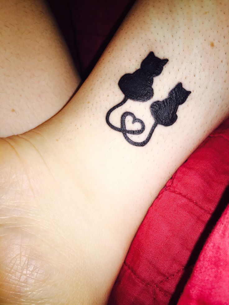 My mother/daughter kitty tattoo.                                                                                                                                                                                  More