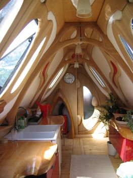 "Narrowboat Leviathan Kitchen. Kris says, ""I love this boat, that is not woodwork, it is ART-freaking-WORK!!!!"
