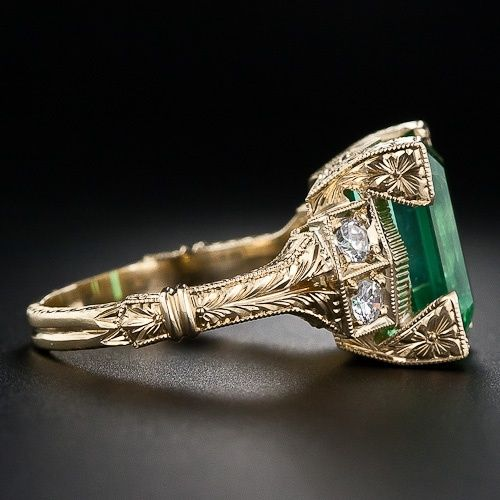 Emerald Rings....holy moly this is gorgeous. Love the gold and intricate detail on the band.