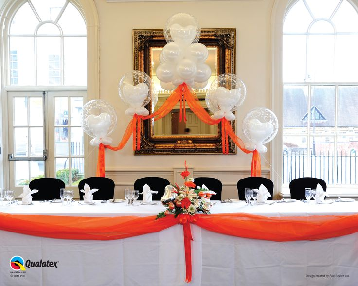 Floating fantasy and orange swag - inject a shot of colour into your wedding with this beautiful double bubble floating fantasy and orange swag - www.justsimplyballoons.co.uk