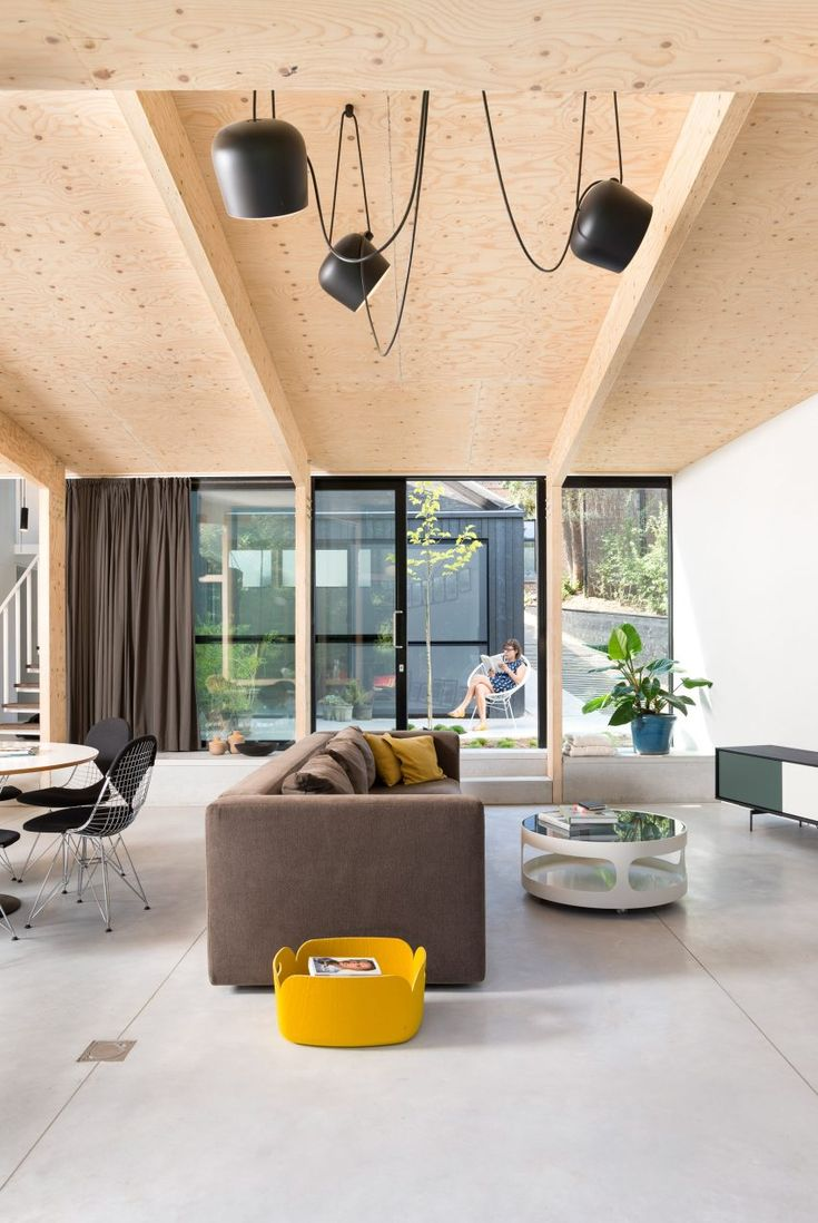 Belgian architect Rob Mols designed a one-storey extension for the semi-detached house in the city of Leuven, adding a gym, an open-plan living space and a master bedroom. Antwerp-based Studio K  oversaw the interior fit-out of both the extension and original house.
