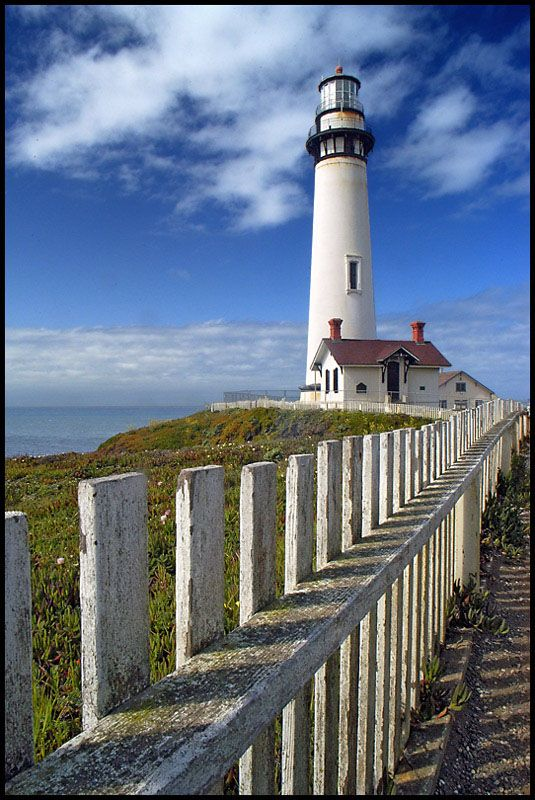 Pigeon Point Lighthouse, California USA ( about 20 miles south of Half Moon Bay near Pescadero.) The lighthouse is closed internally awaiting repairs. This is probably one of the most photographed lighthouses in the USA. (But not by me) Photo cropped, shadows corrected, leveled, and sharpened is PS.