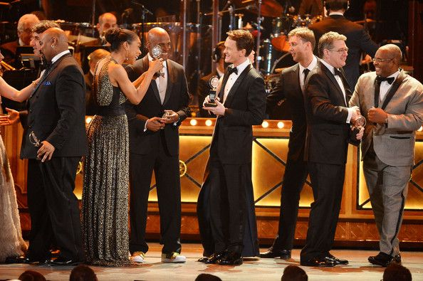 (L-R) James Monroe Iglehart, Sophie Okonedo, Kenny Leon, Neil Patrick Harris, Warren Carlyle and Robert L. Freedman appear onstage during th...