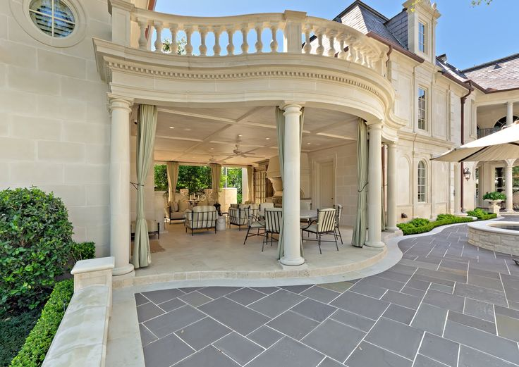 Covered porch and exterior view of a French Baroque House located in  Highland Park, TX