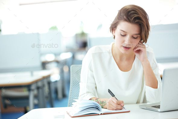Businesswoman Talking On The Phone In Office With Images