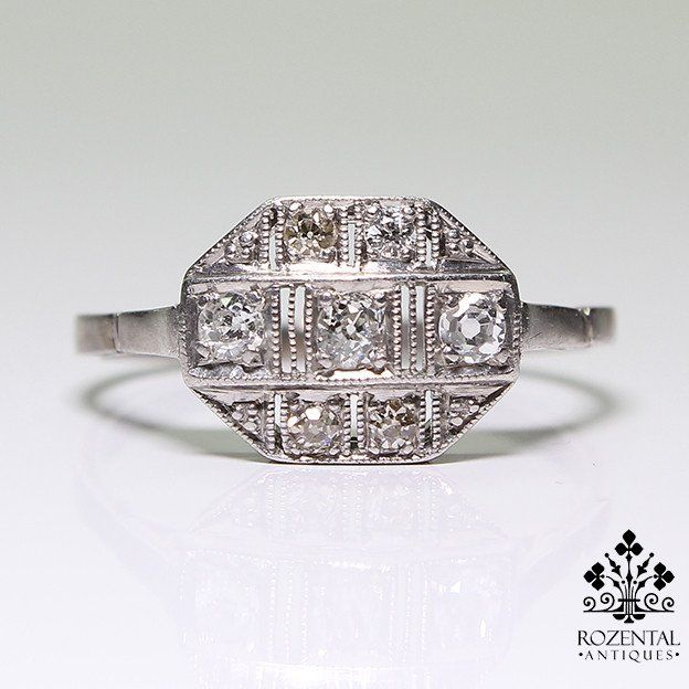 Period: Art deco (1920-1935) Composition: Platinum Stones: - 7 Old mine cut diamonds of H/I-VS2 quality that weigh 0.60ctw. Ring size: 8 1/2 Ring face: 10mm by 14mm Rise above finger: 4mm Total weight