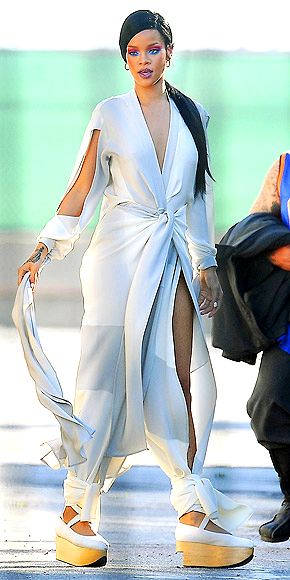 "RIHANNA  Showing less skin than usual in a summery jumpsuit with strategic slits, Rihanna poses pretty on the L.A. set of Coldplay's ""Princess of China"" music video (she's collaborating on their album)."