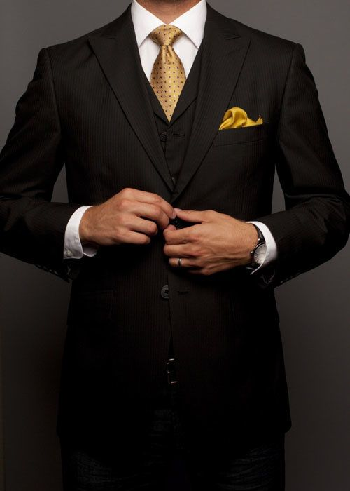 black suit with nice gold tie  yellow pocket highlights