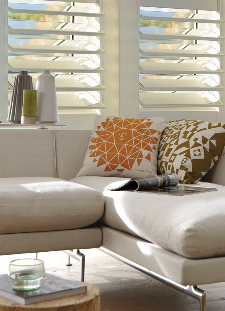 Luxaflex Mirror Shutters in Silver tone create an intriguing effect at the window. #shutters #luxaflex #