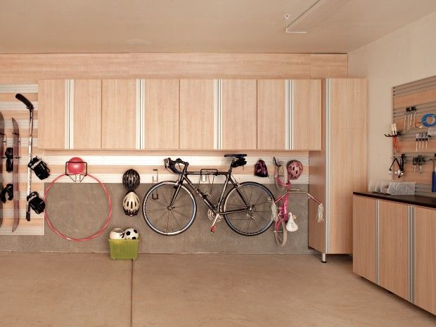 """Under cablinets like this is the best place to hang a bike. It avoids the problematic """"bike stiking out of the wall"""" scenario.(Margarido garage) via California Closets"""