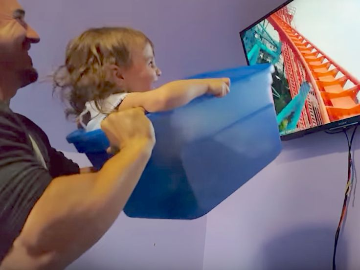 """A dad who couldn't afford to take his daughter to Disney World came up with the cutest solution using household items - The INSIDER Summary:  Victor Peoro created a """"roller coaster"""" for his two-year-old daughterby shaking a bin in front of a screen showing a thrilling ride.  He posted a video of it on YouTube, where it went viral.  A GoFundMe page raised enough money to fund a real Disneyland trip.  Victor Peoro of Hellerton, Pennsylvania, couldn't afford to take his 2-year-old daughter…"""