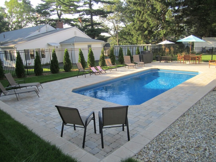 fiberglass pool with paver pool deck