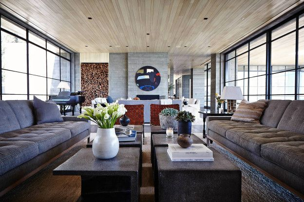 DESIGN SCOTT MITCHELL STUDIO INTERIOR DESIGN DENISE KURIGER DESIGN, LTD. AND SCOTT MITCHELL STUDIO THIS NESTLED MALIBU ESTATE EMERGES FROM A BLUFF OVERLOOKING THE PACIFIC OCEAN. THE LONG, HORIZONTAL FORM OF THE HOUSE'S CENTRAL AXIS IS PUNCTUATED BY TALL, VERTICAL MONOLITHS OF CONCRETE THAT LEND AN ELEGANT RHYTHM TO THE BUILDING'S MASSING. A WING OF …