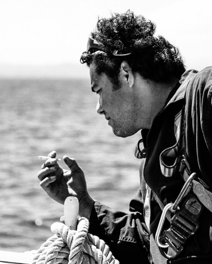 Quick Break.  A sailor on the Belem is taking a quick break before climbing on the mast. We were on the rear deck we often put fishing lines there. With the speed of the ship it would create a nice pace for catching fish such as tuna.  Many sailors are smoking at sea. On the first day aboard the Belem the captain taught smokers not throw cigaret filters at sea. Even though they're small they remain highly toxic.  Summer 2014 - somewhere in the Mediterranean Sea in south of France .