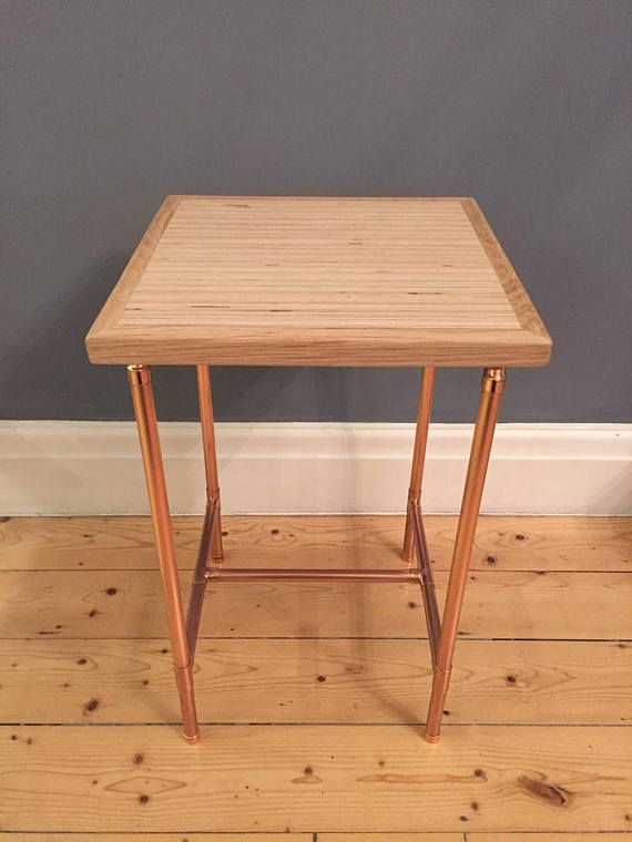 Add a modern industrial feel to your living space with this stunning birch ply and copper pipe side table. Approximate dimensions; Length 31cm (12) Width 31cm (12) Height 50cm (19.5) The top of this table is made from birch ply which has been carefully sanded to a nice smooth finish and