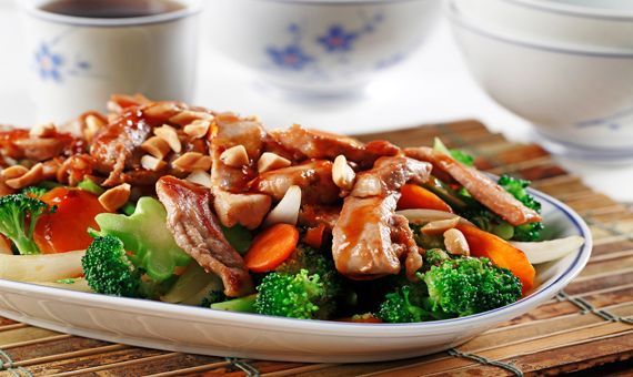 CanolaInfo   Hoisin Orange Pork on Asian Vegetables  Canola oil works well with stir fries because of its high heat tolerance. Get cooking!