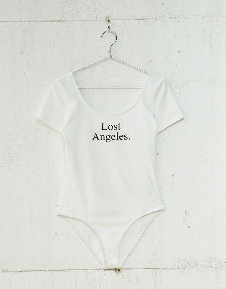 Body algodón elastano texto. Descubre ésta y muchas otras prendas en Bershka con nuevos productos cada semana