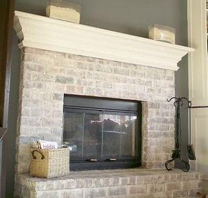 white wash brick fireplace by tamera