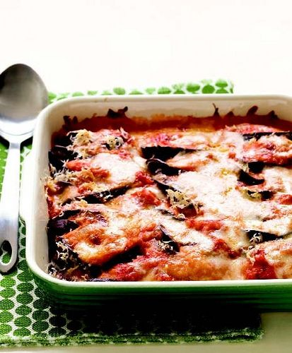 Recipe for Lighter Eggplant Parmesan from Everyday Food: Light                    Who can turn down a piping hot plate of Eggplant Parmesan on a cold night? Martha Stewart Living Magazine makes over this delicious Italian favorite in the healthiest way possible. Skim milk, less cheese and a few other healthy options make this dish much healthier (only 229 calories per serving), without losing any of the flavor. It's comfort food at its be