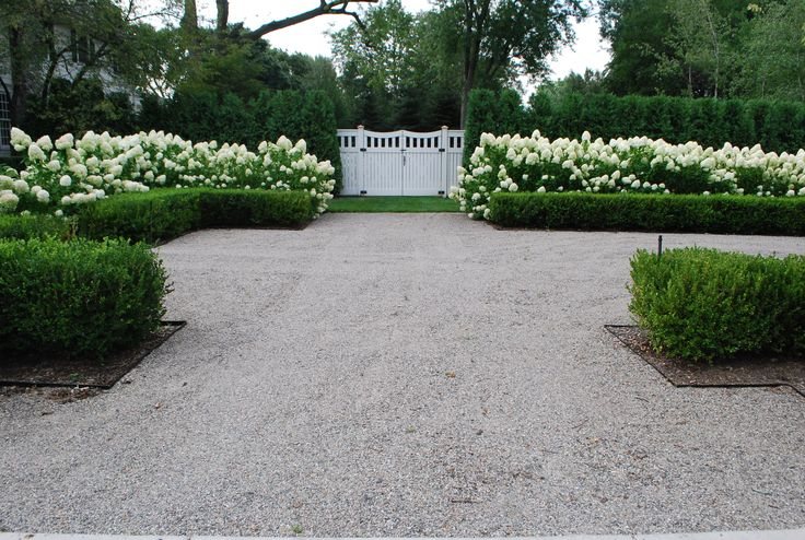 Auto court. This is a great example of how hedged evergreens can formalize a…