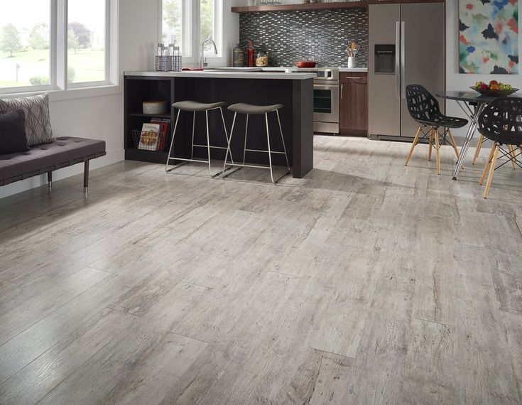 Lumber Liquidators' Click Ceramic Plank Tile Flooring is Durable and Beautiful - The Money Pit #homeimprovement #SpringDIY