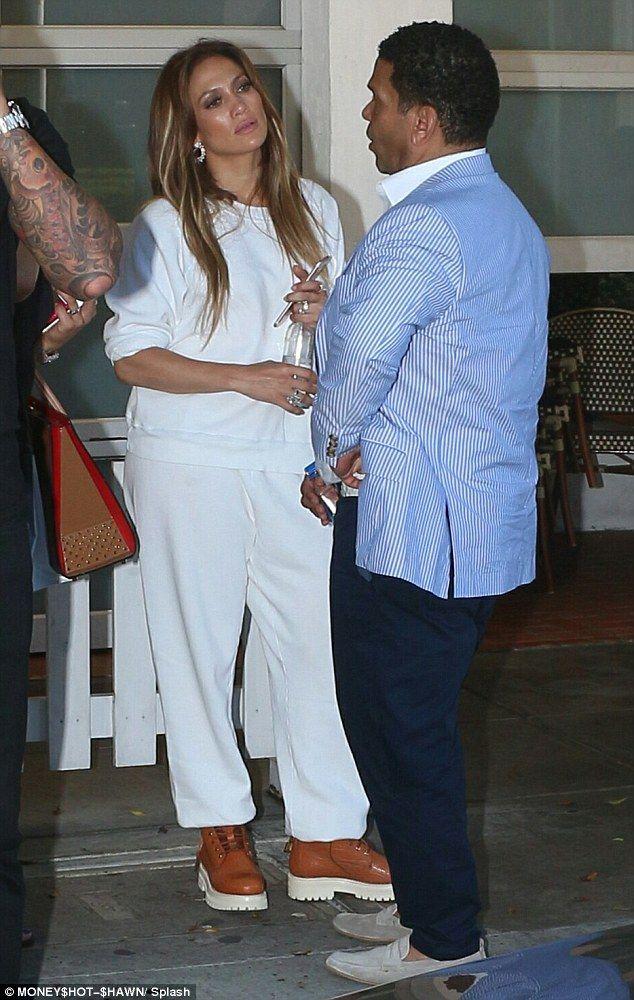 Hot talk: Jennifer Lopez had dinner with her manager Benny Medina at the Fig & Olive in LA...