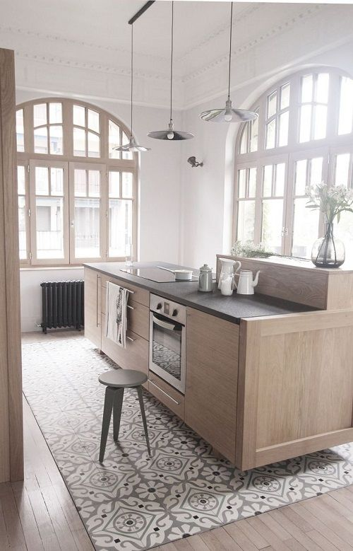 LOVE the stain on the cabinets and trim, plus check out that gorgeous tile detail below the island.: