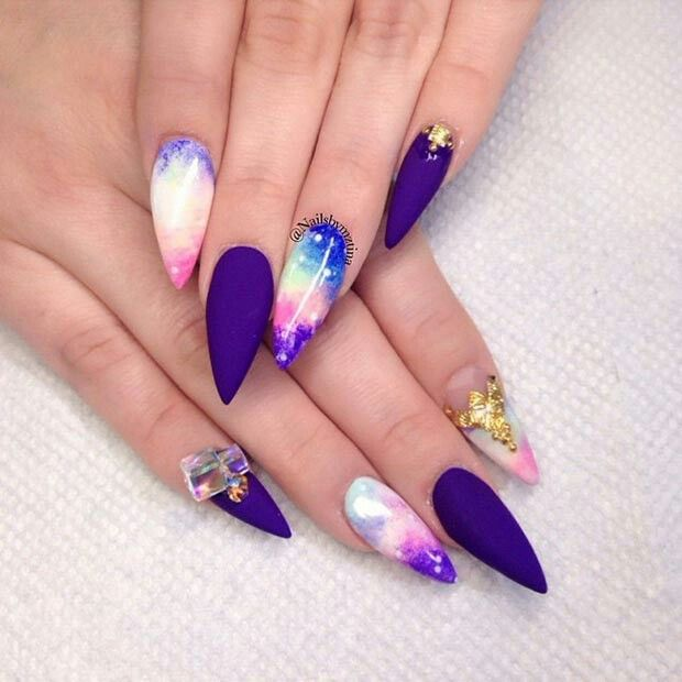 Pastel galaxy and matte purple stiletto acrylics: gorgeous!