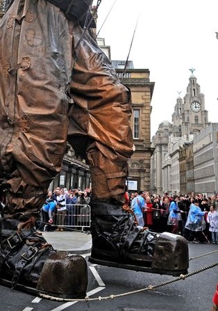 Giant Uncle dwarfs the crowds as he crosses The Strand to make his way up to Liverpool Town Hall as part of the Sea Odyssey