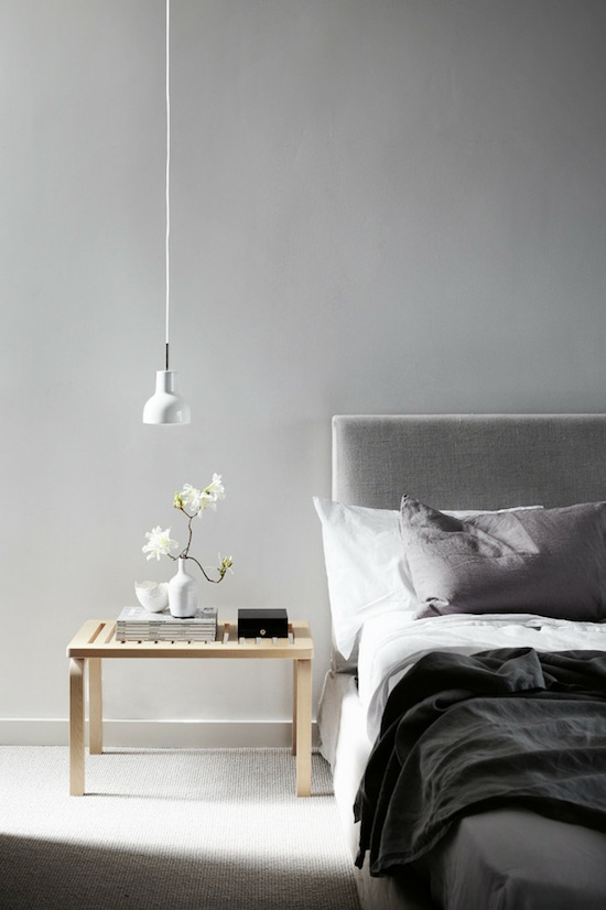 Love this bedroom in muted greys. 'Leila' bed by Jardan and 'Bench 153B' by Alvar Aalto.