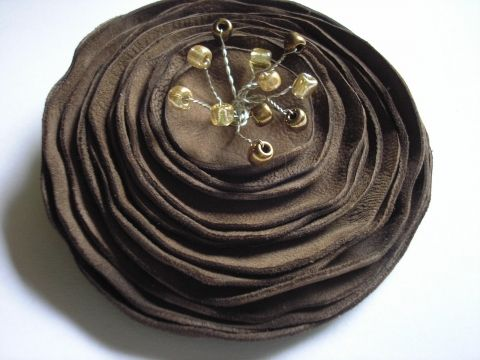 brown leather brooch