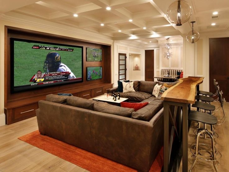 Plenty of seating, a home theater for watching the big game or enjoying a family movie night, and even a place for the kids to work on school assignments -- this basement really does have it all.
