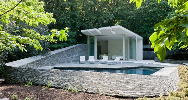 #BedfordResidence #1950s #modern #midcentury #exterior #outside #outdoors #landscape #green #structure #deck #stone #pool #poolhouse #chaiselounge #Bedford #BalmoriAssociates #JoelSandersArchitect