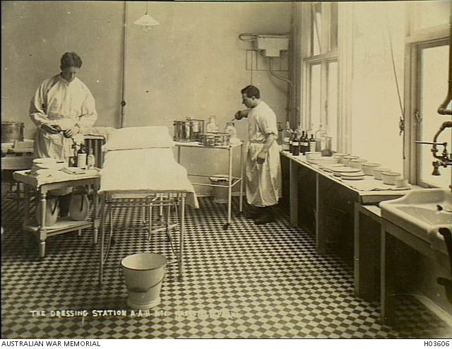 Harefield, England. c. 1918. Two male staff members of No 1 Australian Auxiliary Hospital working in the dressing station.