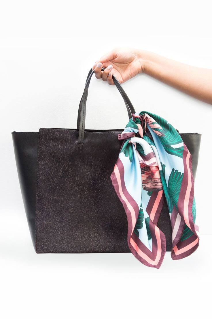 Tie a silky scarf around the handle of your bag. Seriously, it's one of the easiest ways to dress it up and it's totally ladylike and retro. We love bright jewel tones and floral combinations for spring.  Shop the Look: H&M Print Scarf, $24.95; hm.com. Bag Credit: ASOS Pony Effect Leather Handheld Bag, $109; asos.com.   - MarieClaire.com