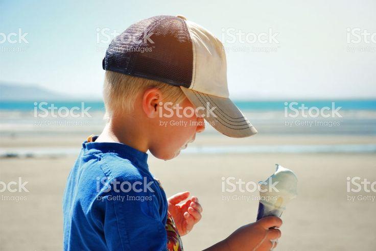 Child Eating Ice Cream at Beach royalty-free stock photo