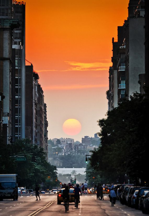 "Each year on May 30 - 31st the setting sun aligns with Manhattan's grid, creating a dramatic effect which locals have dubbed ""Manhattanhenge""."