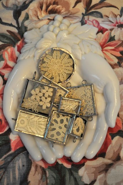 soldered charms with bits of lace and tatting